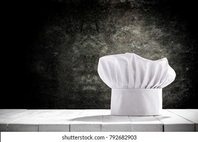 Cook hat and wooden table of free space