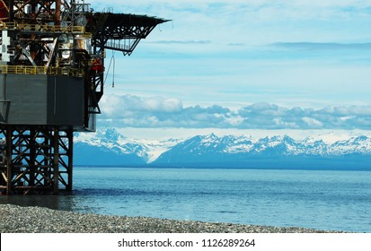 Cook Inlet and mountains with Oil platform service station