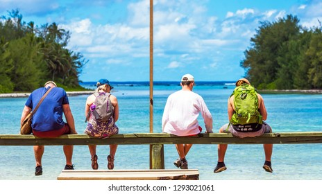 COOK ISLAND, SOUTH PACIFIC - SEPTEMBER 30, 2018: A group of people in the background of the sea landscape. With selective focus. Back view
