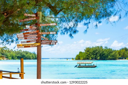 COOK ISLAND, SOUTH PACIFIC - SEPTEMBER 30, 2018: Wooden sign indicating the direction to different cities of the world. With selective focus