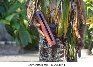 Cook Islander man plays on a small Pate wooden stick drum instrument in Rarotonga, Cook Islands.Rael people. Copy space