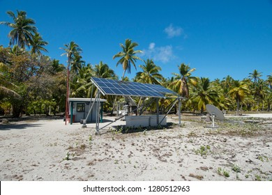 Cook Islands. Palmerston Island, a classic atoll, was discovered by Captain Cook in 1774. Current population of 62 people, all descendants of William Marsters. Solar panel for island power.