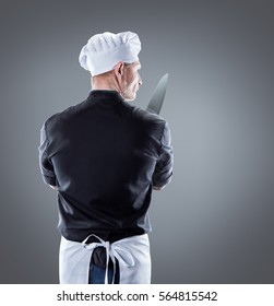 Cook with knife view from back. 3D rendering and photo. High resolution.