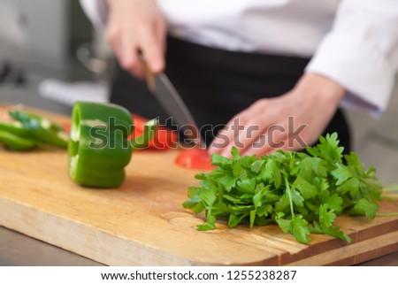 cook-makes-salad-closeup-womans-450w-125