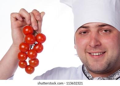 Cook man has cherry tomatoes