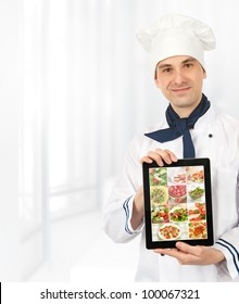 cook man showing a digital tablet with menu