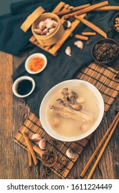 A cook is preparing a Bak kut teh for service to his customer in a Chinese restaurant.
