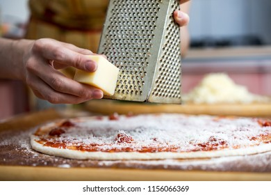 Cook preparing pizza