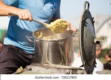 the cook puts pumpkin porridge on a plate