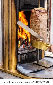 Cook slices shawarma from the spit for doner kababs  in Mardin,  Turkey
