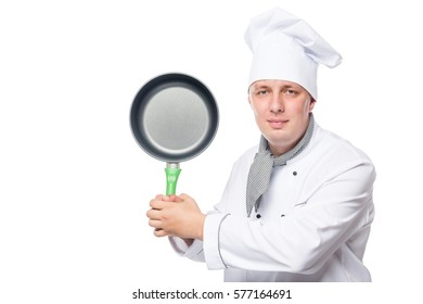 Cook in a suit with empty frying pan posing