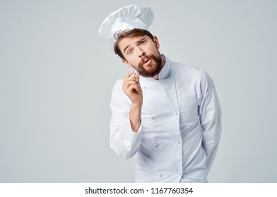 the cook tilts his head to one side and joins a large index finger