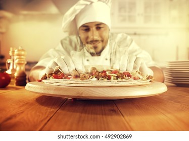 cook in white clothes and golden hour sun light in kitchen