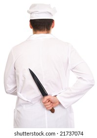 Cook in a white dressing-gown holding in a hand kitchen knife