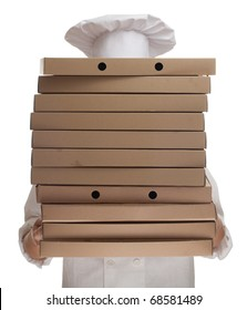 cook in white uniform and hat with boxes of pizza