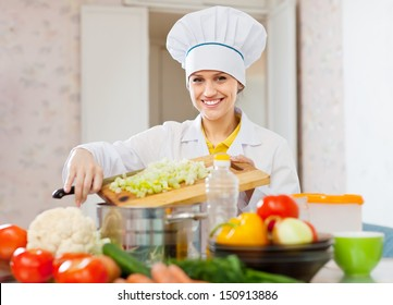 cook woman cooking vegetarian dinner  at  kitchen