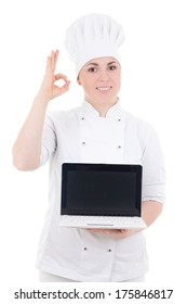 cook woman holding laptop with empty screen and showing ok sign isolated on white background