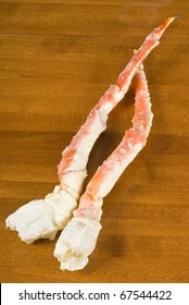 Cooked Alaskan Crab Legs on a Wooden Table
