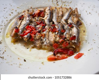 Cooked anchovies in olive oil with roasted bell peppers