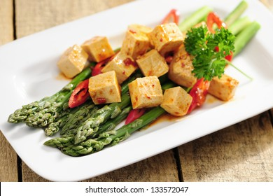 Cooked Asparagus and marinated Tofu, selective focus