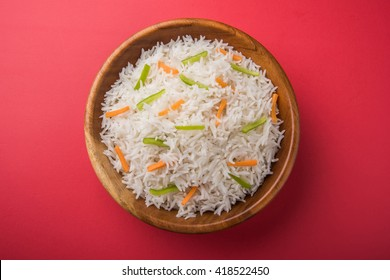 cooked basmati rice with carrot and capsicum toppings also known as plain white pulav. selective focus