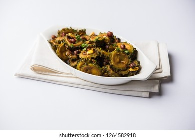 Cooked bitter Melon/gourd or Karela Sabzi served in a bowl. Scientific name of this healthy vegetable is Momordica charantia. selective focus
