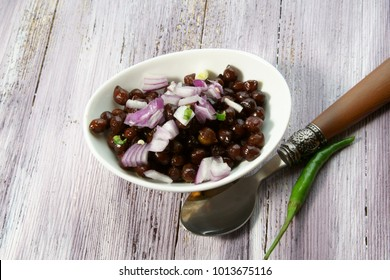 Cooked Black Chana with chopped red onions and green chilies.