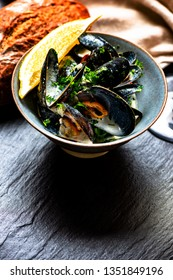 Cooked Blue mussels in clay dish