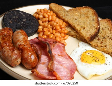 Cooked breakfast with black pudding, baked beans and fried bread.