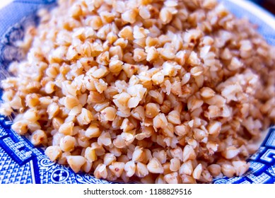 Cooked buckwheat on the plate.