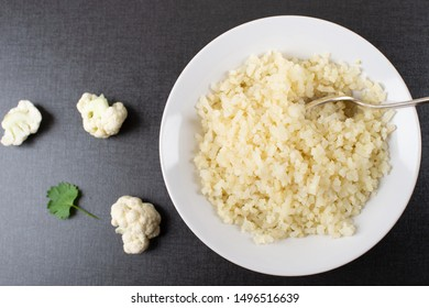 Cooked Cauliflower rice in a bowl