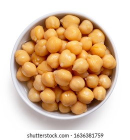Cooked chick peas in a white ceramic bowl isolated on white. Top view.