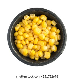 Cooked Corn Kernels Heap in Black Iron Bowl Top View Closeup Isolated