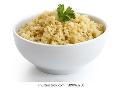 Cooked couscous with green parsley in white ceramic bowl isolated on white.