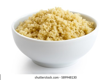 Cooked couscous in white ceramic bowl isolated on white.