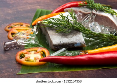 Cooked fish cobia on a wood background. Flat lay. Top view with copy space.