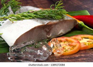 Cooked fish cobia on a wood background. Flat lay. Top view with copy space