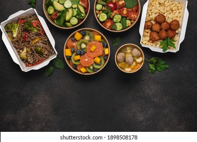 Cooked food in paper eco-friendly containers. Food delivery for home or office. Vegetable, fruit salads, soup, meat and side dishes