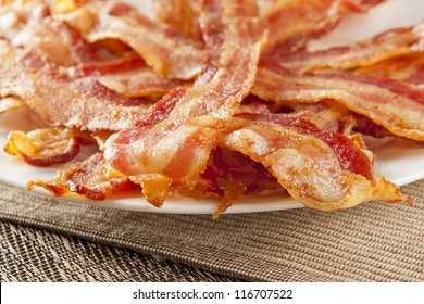 Cooked Greasy Bacon against a back ground