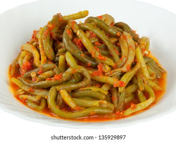 Cooked green bean with tomato sauce on white background
