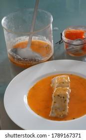 Cooked halibut with crustacean sauce