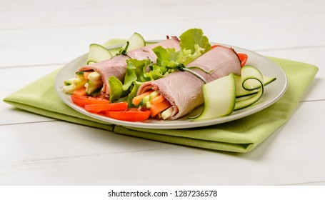 Cooked ham with julienne vegetables