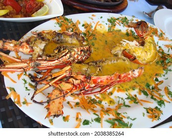 Cooked lobster with sauce and vegetables - Shutterstock ID 2038385264