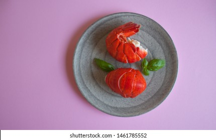 Cooked lobster tails and basil on plate, healthy food. - Shutterstock ID 1461785552