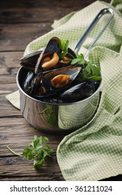 Cooked mussels with garlic and parsley, selective focus