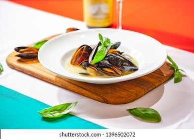 Cooked mussels on white plate. Close up