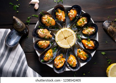 Cooked Mussels. Steamed mussels in white wine sauce with parsley and garlic. Tasty spanish seafood recipe. Top view