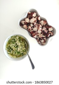 Cooked octopus with green sauce.
