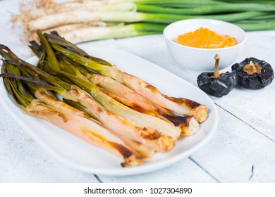 Calçots cooked on the fire, typical food of Catalonia