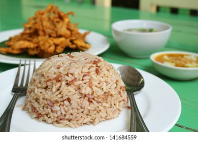 cooked organic brown rice and deep fried sajor-caju mushroom patty or mushroom cake serve with vegetable soup and its sauce